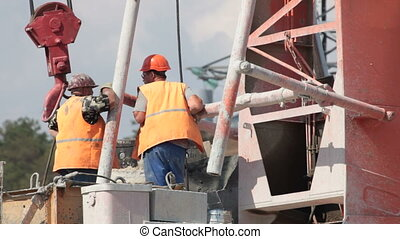 Builders on construction site - builders at the construction...