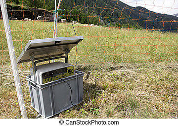Solar energy panel with electric fence in Swiss Alps