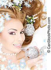lovely woman with christmas balls - picture of lovely woman...
