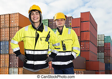 Two Dockers - Two happy harbor workers posing in front of a...