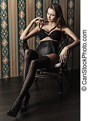 imposing - Seductive young woman in sexual lingerie posing...