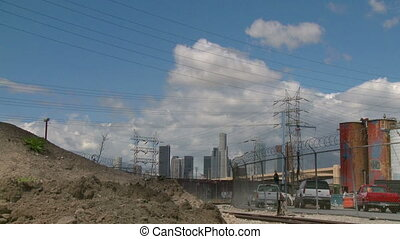 Industrial LA - Time lapse view of clouds passing over an...