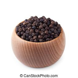Wooden bowl full of black pepper isolated on white...