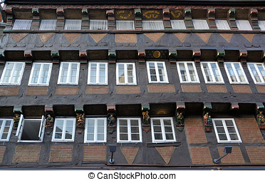 a historic timbered house - The facade of a historic...