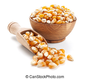 corn grain in a wooden bowl isolated on white background