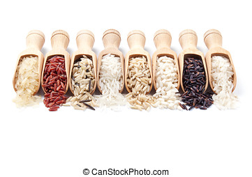 Wooden scoops with different rice types scattered from them...