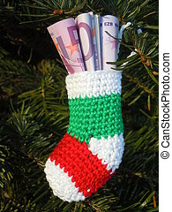 christmas stockings with banknotes