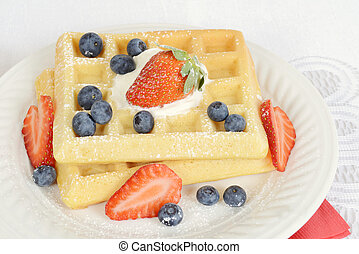macro waffles with blueberries and strawberries