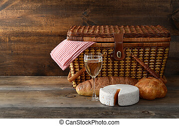 old picnic basket with wine