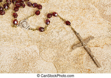 Rosary on stone - Rosary beads on a sandstone background