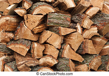 Wood pile - Closeup of a wood pile with chopped oak firewood
