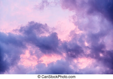 Clouds - Stormy sky with dark clouds and multicolored light...
