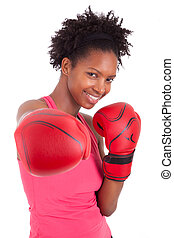 Portrait of a fitness woman wearing boxing gloves, isolated...