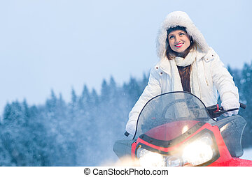 Woman and snowmobile - Winter, beautiful woman and a...