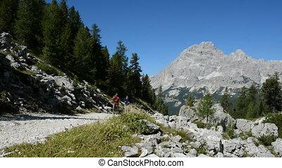 Mountain trekking - Two young men walking and beautiful...