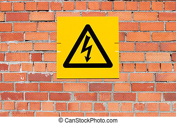 Yellow Danger of Death Warning sign on a brick wall
