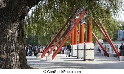 Visitors enter scenic area and willow trunk branches in...