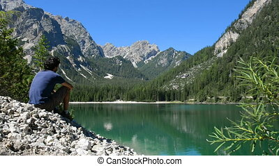 Relaxing with breathtaking view - Young man contemplate the...
