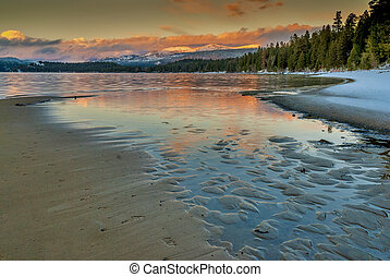Beach and lake in the mountains winter sunset - Winter...