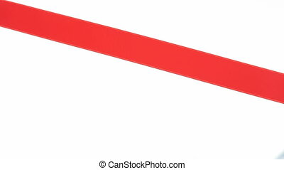 Red ribbon cutting - HD1080p: Hand cutting a red ribbon for...