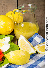 Salad with lemon dressing and egg - Salad with citrus...