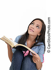Beautiful young woman holding a Bible