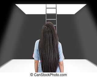 woman standing in a pit looking up to the ladder that leads out in to the light.