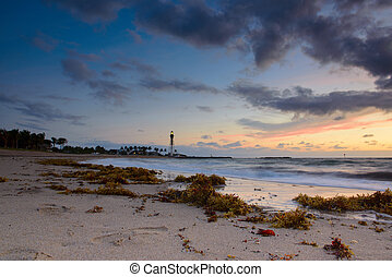 Hillsboro inlet lighthouse - Lighthouse on a beach at...