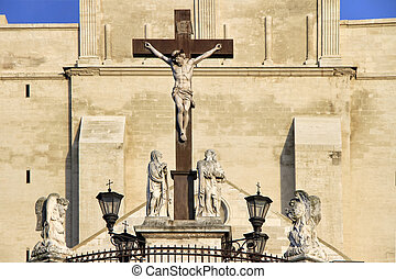 The Popes' Palace in Avignon, France: Statues in front of...