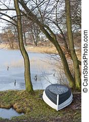 Dinghy at a the Frozen Lake - Dinghy at a frozen lake near...