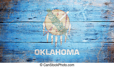 Flag of the state of Oklahoma painted on grungy wooden...