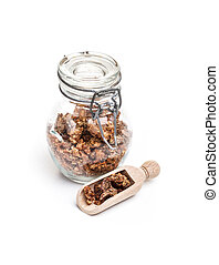 Propolis in a glass pot on white background