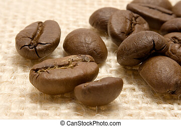 Coffee Beans on Linen - Close-up on coffee beans on beige...