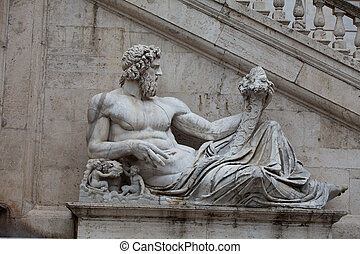 Rome - Sculpture of Tiber river in the Capitolium planed by...