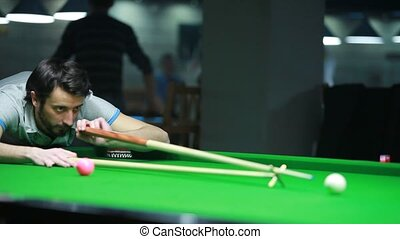 Snooker player - Young man playing billiard snooker