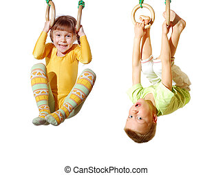 children playing and exercising on gymnastic rings -...