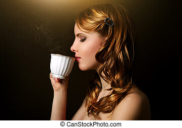 Cup Of Fragrant Coffee - An attractive girl with a cup of...