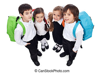 Happy school kids with back packs - holding each other,...