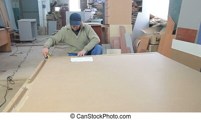 Carpenter at Work - carpenter calculating layout dimensions