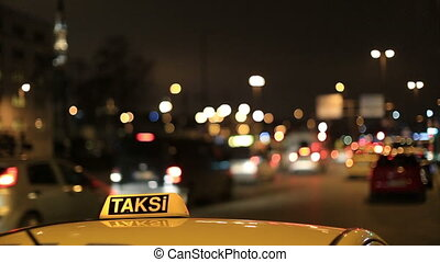 taxi sign - close up taxi sign with night traffic light