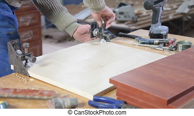 Furniture maker at work in workshop - Cabinet maker at work...