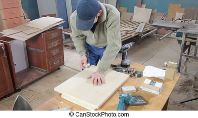 furniture workshop - Furniture maker at work in workshop,...