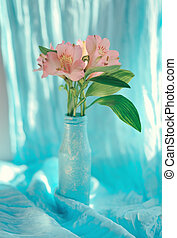 decorative flowers - on a blue background and a blue vase...