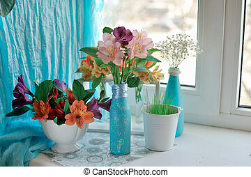 decorative flowers - on the window sill with a blue curtain...