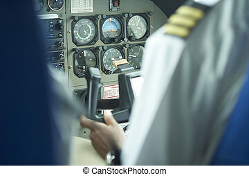 control panel on a cesna airplane - controls with a pilot in...