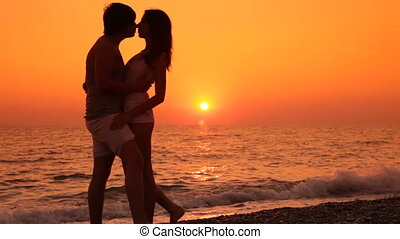 Teen couple vacation on the beach - Teen couple embracing on...