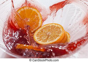 Orange splah in orange juice - Orange slices splash in...