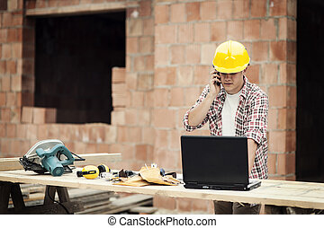 Carpenter talking on mobile phone