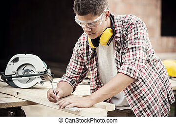Carpenter measuring a