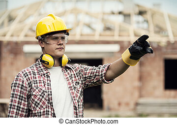 Construction worker pointing at something